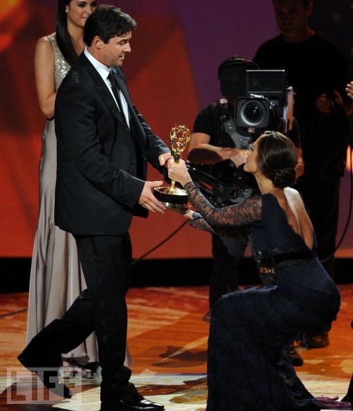 2011  LEAD ACTOR IN A DRAMA: Kyle Chandler  Finally! After several years of fans complaining he's been egregiously snubbed for his work on Friday Night Lights, Chandler took home the Emmy for the show's final season. Pictured: Presenter Minka Kelly bows down.