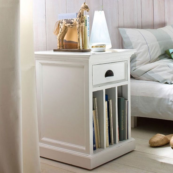 The Halifax white painted bedside table features a single drawer and three vertical slots ideal for storing books and magazines.
