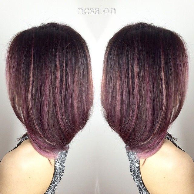 Pink highlights on dark hair. Rose gold?