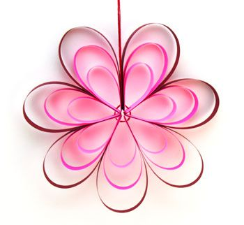 Paper, yarn and holes turn into a simple yet pretty Paper Strips Flower decoration for any time of the year.