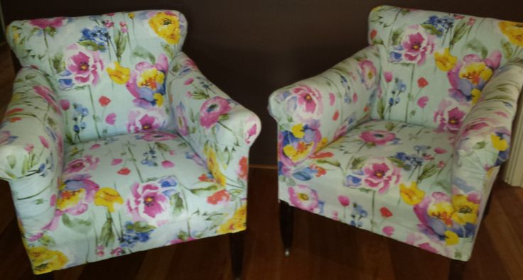 Old chairs re-upholstered with light blue flowers...