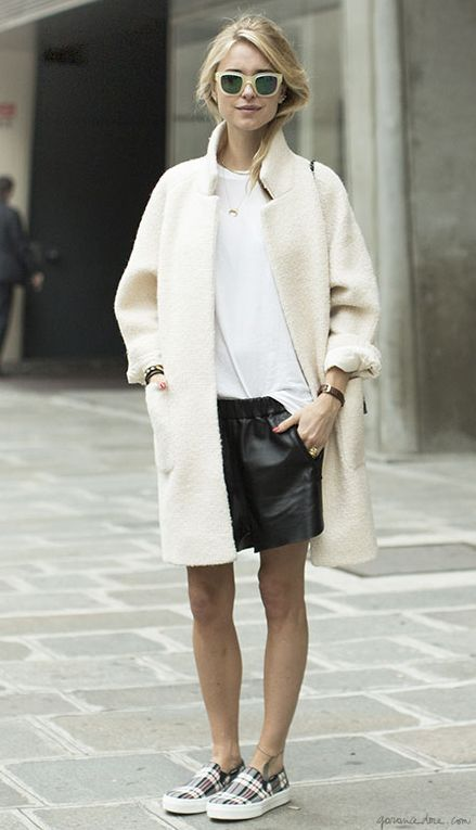 leather shorts and a long coat