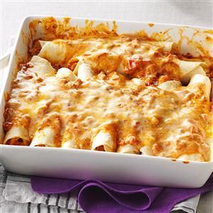 Simple Creamy Chicken Enchiladas Recipe -This is one of the first recipes I created and cooked for my husband right after we got married. He was so impressed! We fix these creamy enchiladas for friends regularly. —Melissa Rogers, Tuscaloosa, Alabama