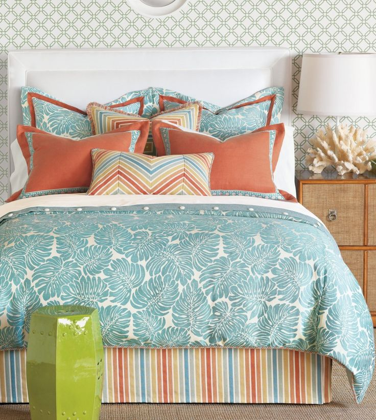 Artistic Teal and Coral Chevron Bedroom with Turqoise Floral Bedding and White Table Lamp Idea