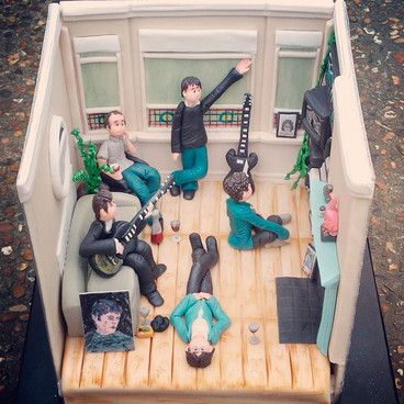 love this cake replica of Oasis' 'Definitely Maybe' album cover to celebrate 20 years since the release of the British classic.