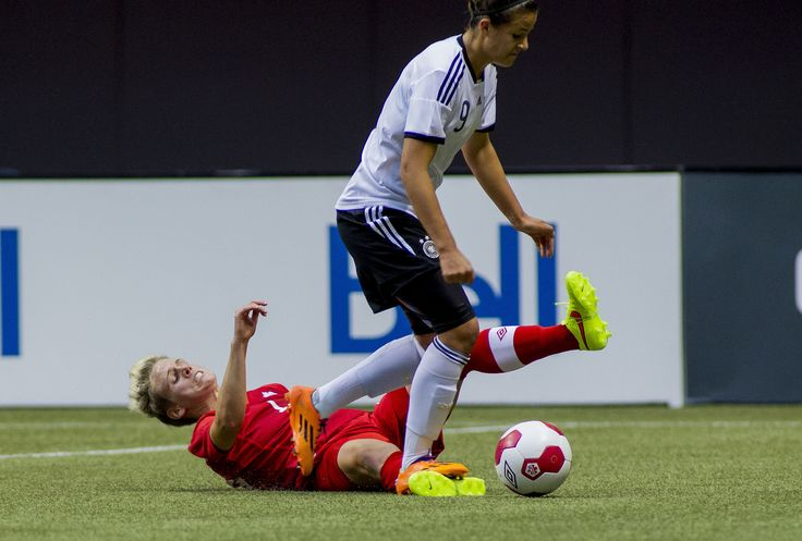 Sophie Schmidt  - No 9 Germany (Lotzen) stepped on Sophie Schmidt's foot - definitely not by accident. This is what players often do  - referees usually don't see it!  20140618_Schmidt_byFrid01