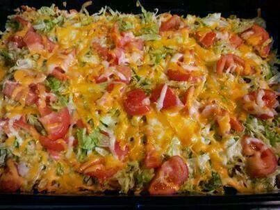 Taco casserole: crushed cchips, taco seasoned beef, shredded cheese, cook; add lettuce tomato n more cheese, top with sour cream