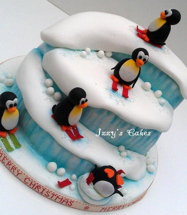 Rich fruit cake, carved into a ski slope with handmade sugar penguins!