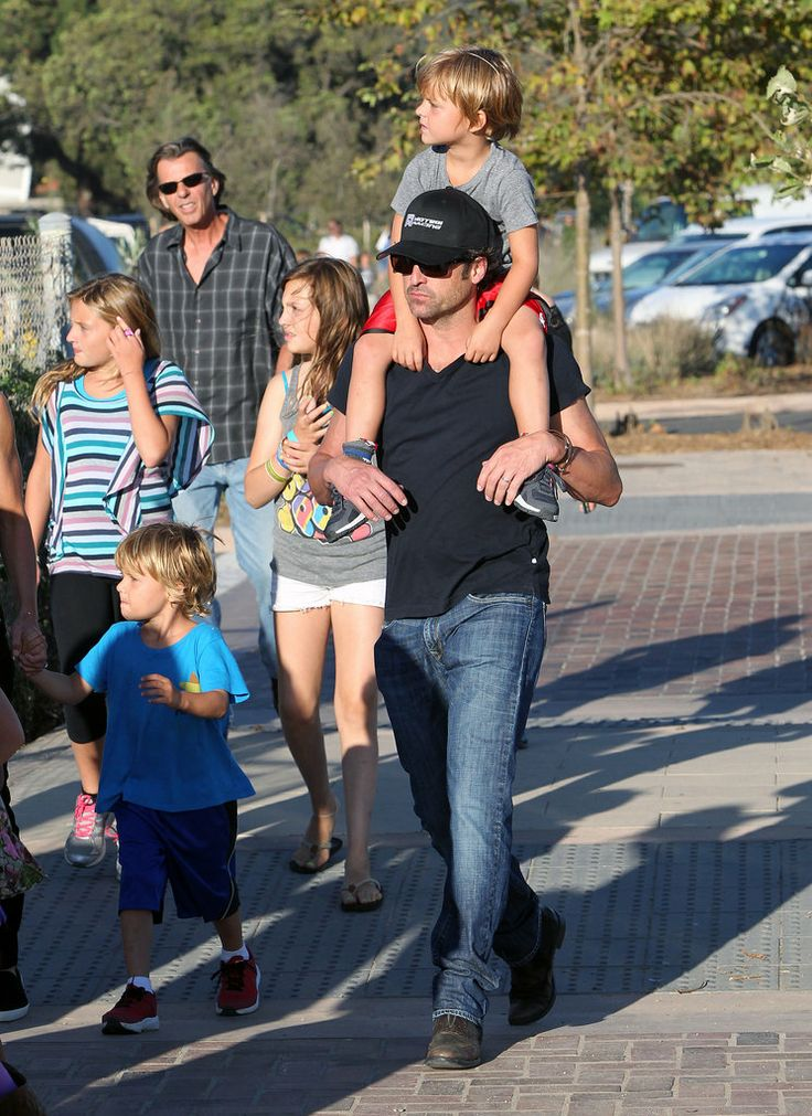 Patrick Dempsey carried one of his twins on his shoulder during an outing in Malibu in August 2012. #celebrities #celebrity dads #celebrities' kids