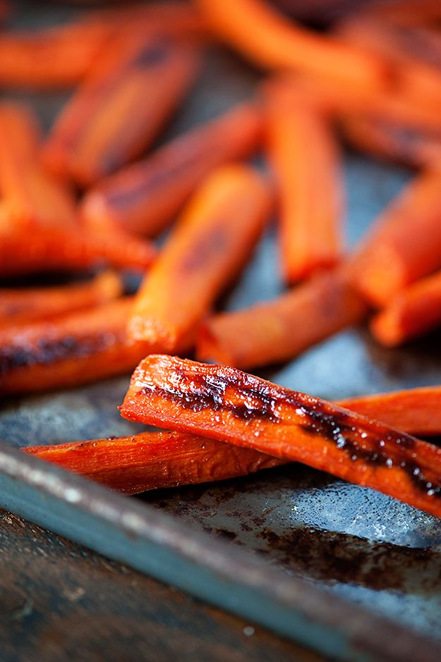 These maple glazed carrots are roasted in the oven and sprinkled with a bit of cayenne for an unexpected spicy kick! Tell me something, would you? How do you feel about sweet and spicy? Are you a fan? I love a little sweet with my spice. Maybe because I'm a wimp or maybe just because …