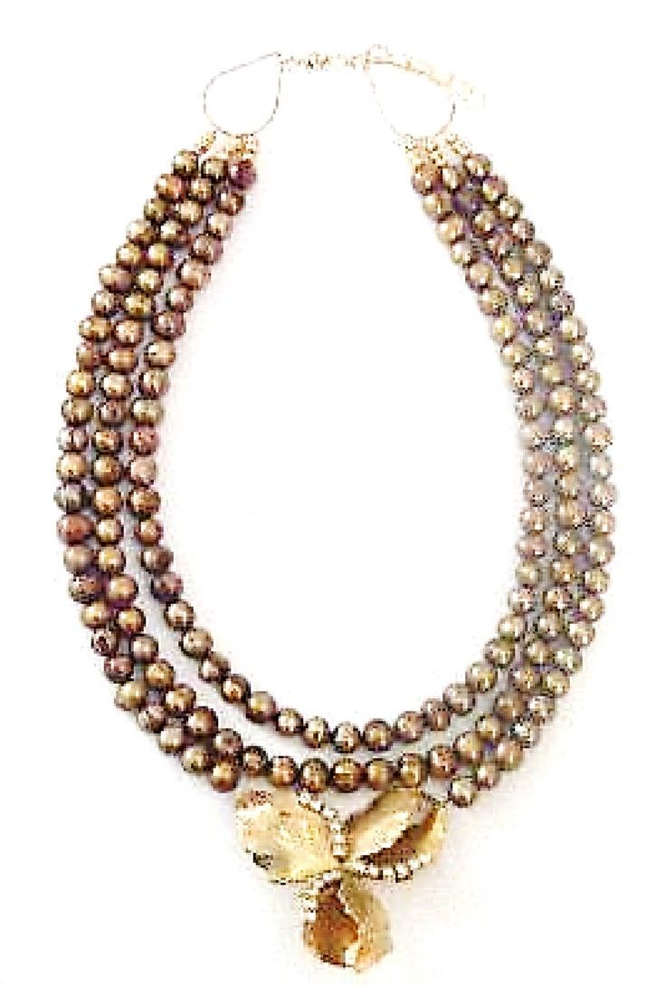Gold freshwater pearls & Leaf clover brooch necklace.  One-of-a-kind statement necklace. Handmade with bronze freshwater pearls paired with vintage brooch $250,00. #freshwaterpearl#statementnecklaces#necklaces#handmadenecklace