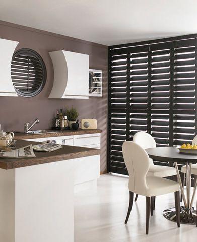 Dark colored plantation shutters... So chic. Blindfolded.co.uk