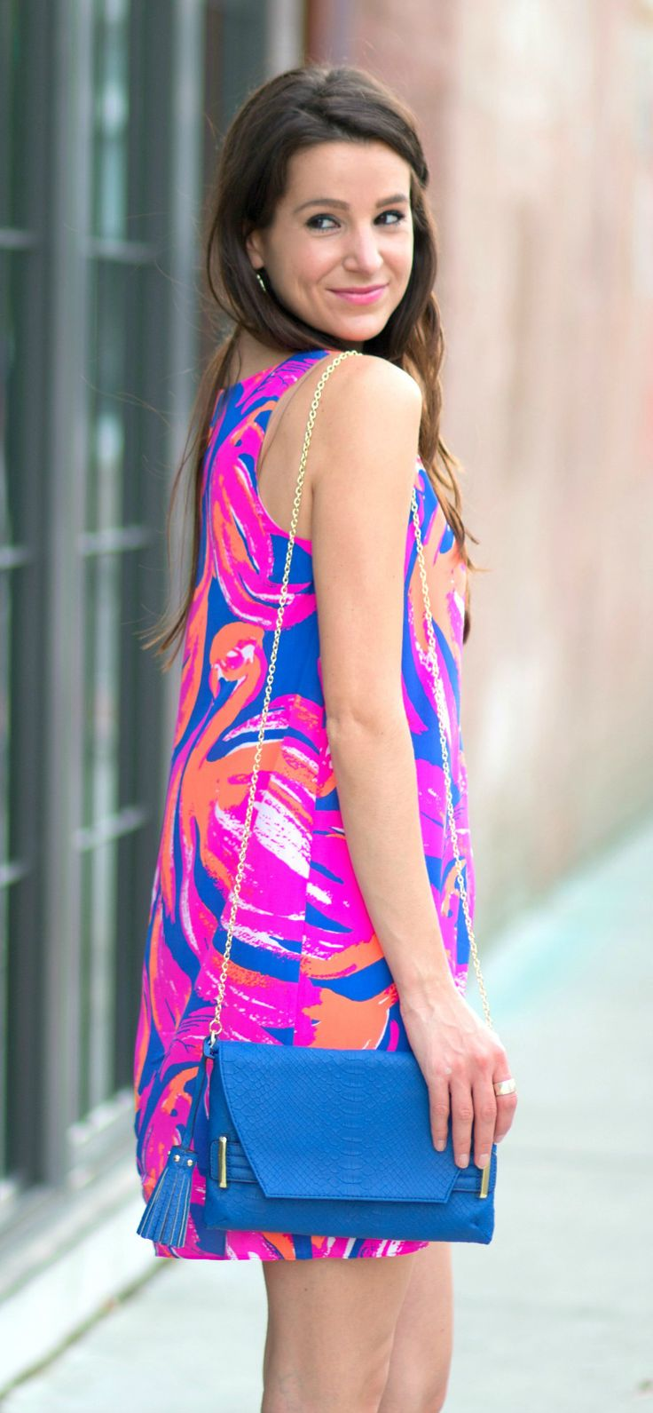 Lilly Pulitzer Jackie Shift Dress with a cobalt crossbody bag, white perforated pumps, and white, blue, and pink Kendra Scott Brynn bracelets |  Cocktails in Charleston: Lilly Pulitzer Summer Shift Dress by Stephanie Ziajka from Diary of a Debutante