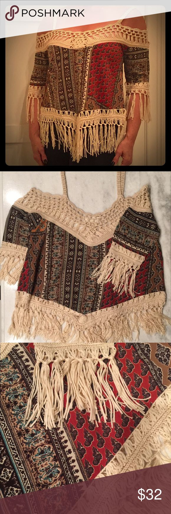 Dreamers Boho fringe top Boho off the shoulder top with straps. Soft cotton/acrylic print fabric with ivory fringe. Size medium but fits like a large. Occasion Tops Blouses