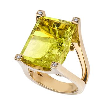 """18kt yellow gold high polish ring featuring a yellow citrine that is naturally cleaved emerald cut and prong set in a """"U"""" shape prong basket. There is a d"""