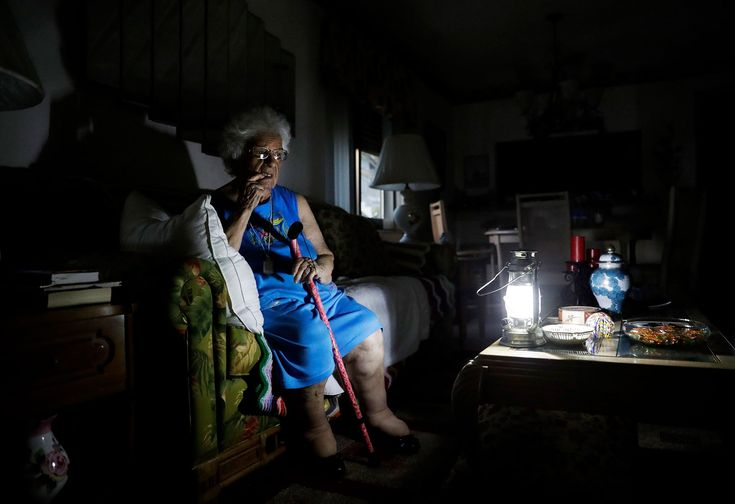 "Mary Della Ratta, 94, sits by a Mary Della Ratta, 94, sits by a battery-powered lantern in her home on Sept. 13, three days after Hurricane Irma knocked out power in Naples, Florida. ""I don't know what to do. How am I going to last here?"" said Della Ratta. About 6.8 million people remained without electricity for days in the steamy late-summer heat as a result of Irma.battery-powered lantern in her home"