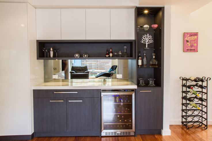 Modern home bar. Wine fridge. Mirror splashback. www.thekitchendesigncentre.com.au