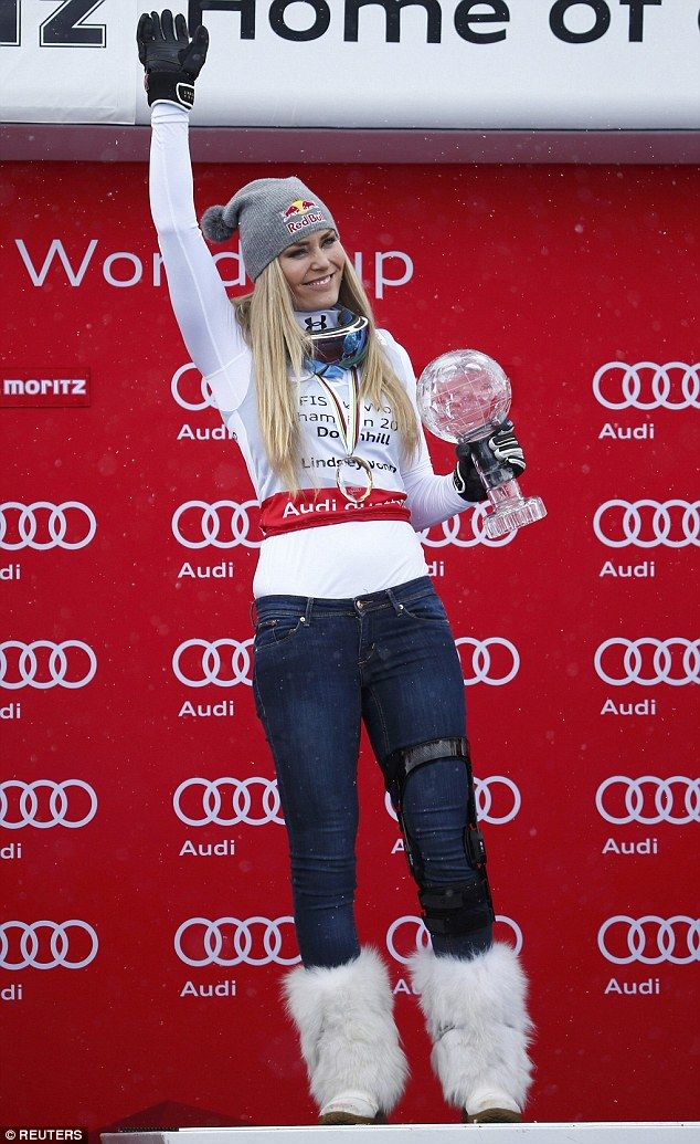 Skier Lindsey Vonn donned a knee brace, fluffy boots and a beaming smile as she picked up her World Cup downhill trophy in Switzerland today