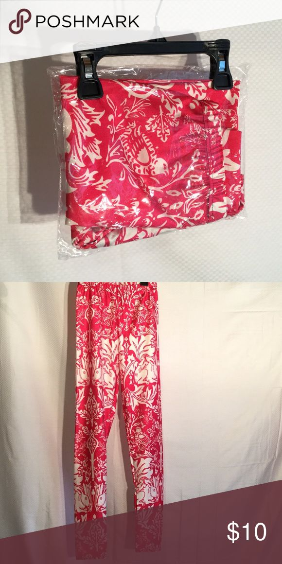 Ladies workout pants hot pink/white Ladies hot pink and white floral workout pants never worn and still in the ordinal shipping pouch Pants Leggings