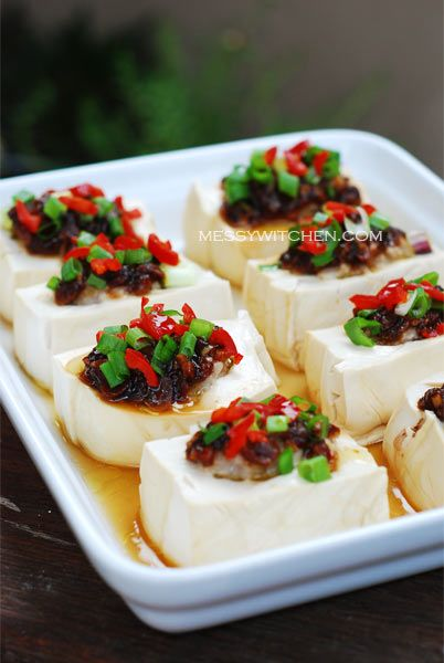 Steamed soft tofu with a ground pork filling, topped with a garlic ...