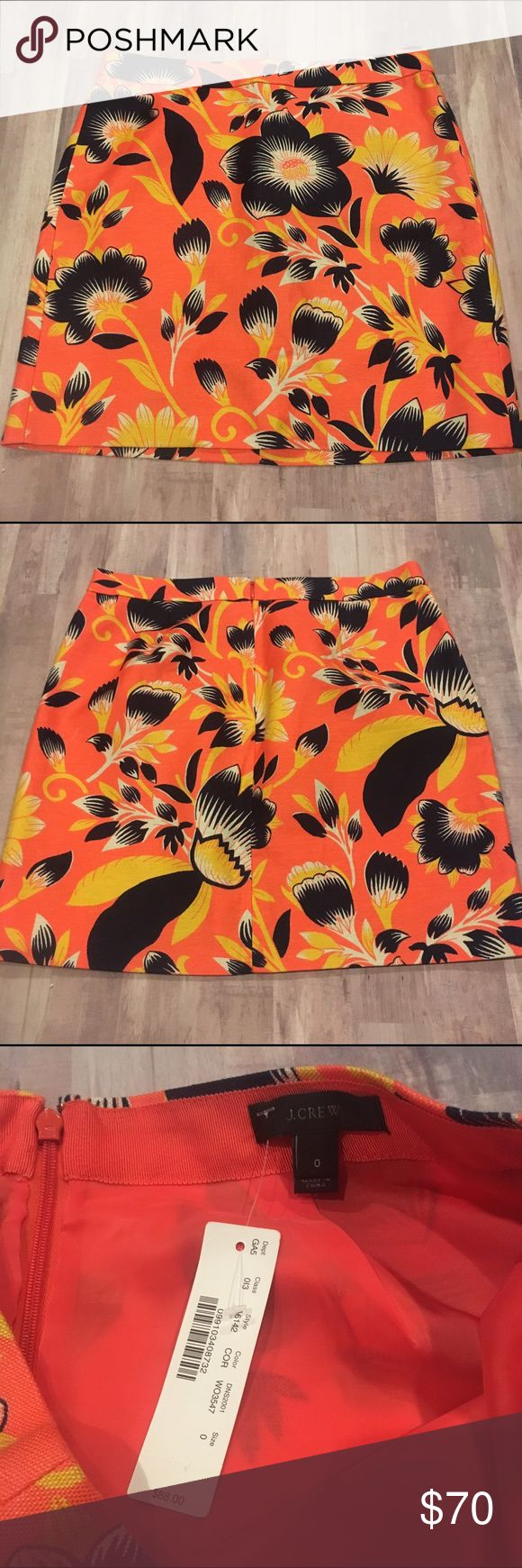 J. Crew Postage stamp mini in hibiscus Floral Crafted from a structured blend of linen and cotton in a subtle A-line shape, this mini features a bold tropical floral inspired by California's surfer culture (we love how the navy blooms pop against the neon background). And while we love a short and sweet silhouette, we went to great lengths to tweak the hem, so you'll never feel overexposed. NWT!  Linen/cotton. Back zip. Lined. Machine wash. Falls above knee, sits at hip. J. Crew Skirts Mini