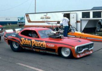 In the mid-seventies, funny cars got lower and lower in an effort to be more aerodynamic. The Pusch & Cain Satellite driven by Ray Motes was a great example of this. The short Mopar was a super tough racer, but was probably hard to see out of!