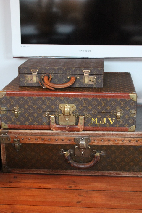 Stack of vintage Louis Vuitton suitcases