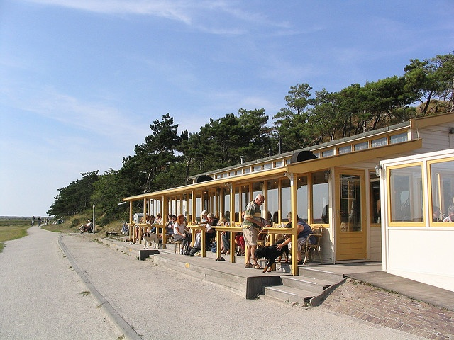 walvis terschelling netherlands!  Coffee Behind glass, or a nice glass of wine at the end of a long day of cycling... Always against the wind!