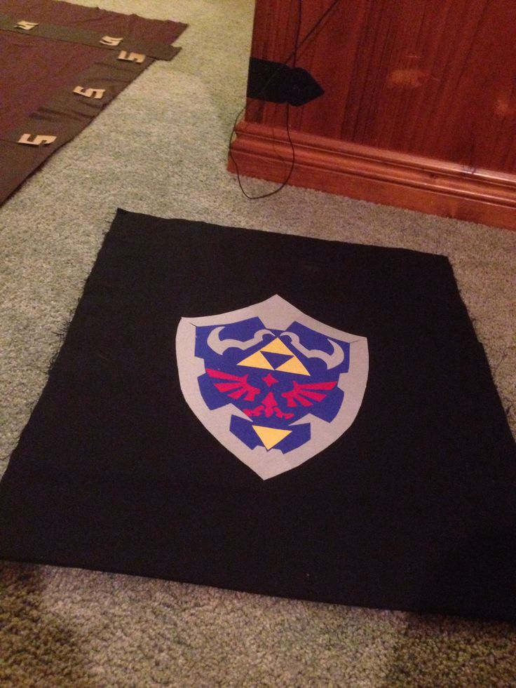 Zelda sheild pillow case, made from scraps and blown up pic of sheild.