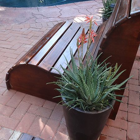 Garden love seat / This slatted garden bench makes the perfect love seat for a garden. It's very easy to make. YOU WILL NEED:1 of 900 x 900mm 16mm marine plywood*, 7 of 20 x 94mm PAR pine - cut to 1040mm length, 12 of 20 x 69mm PAR pine,  3 cut to 1000mm length,  9 cut to 1040mm length, 5 x 50mm cut screws, Wood glue, Wood filler (tinted for finished color, Wood sealer, Mineral turpentine, Rags