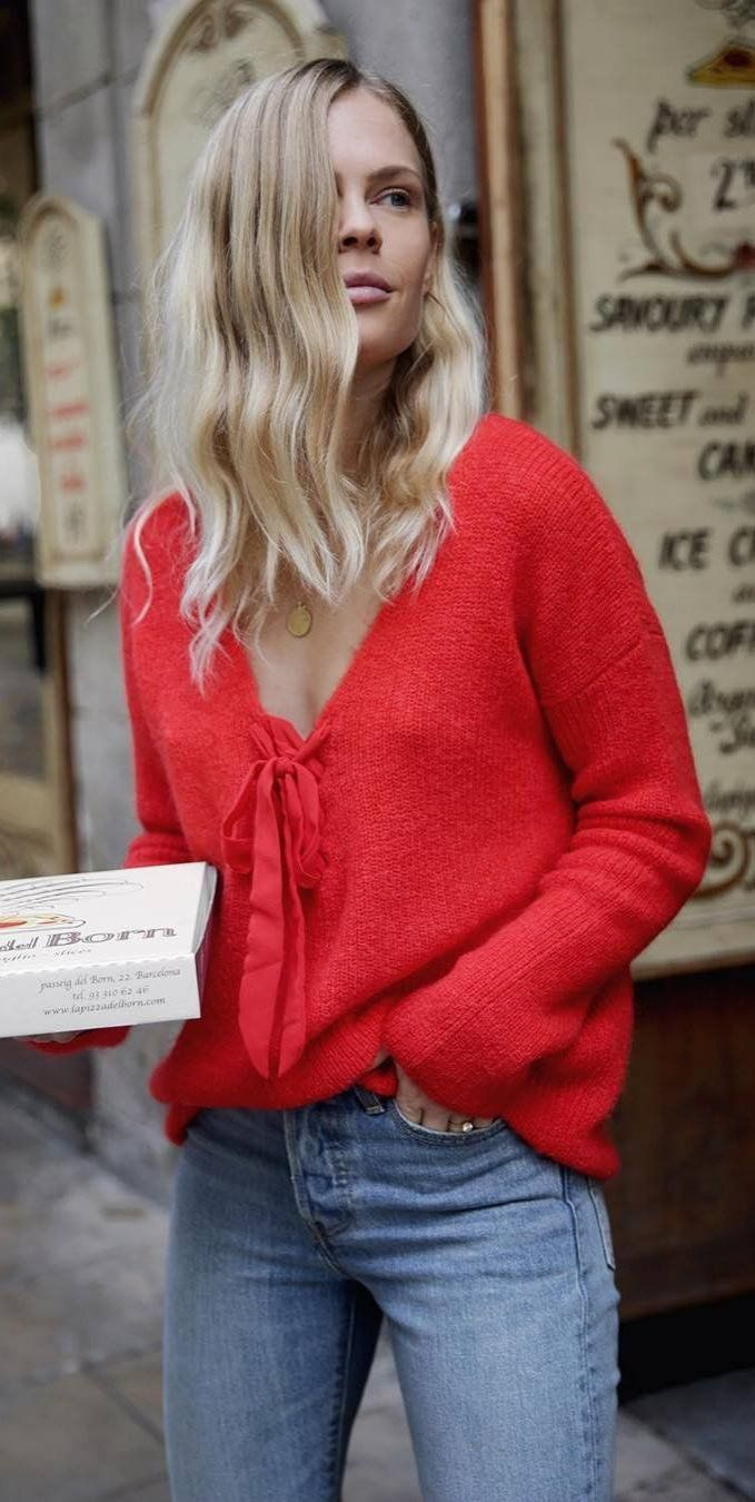 red cashmere sweater and jeans