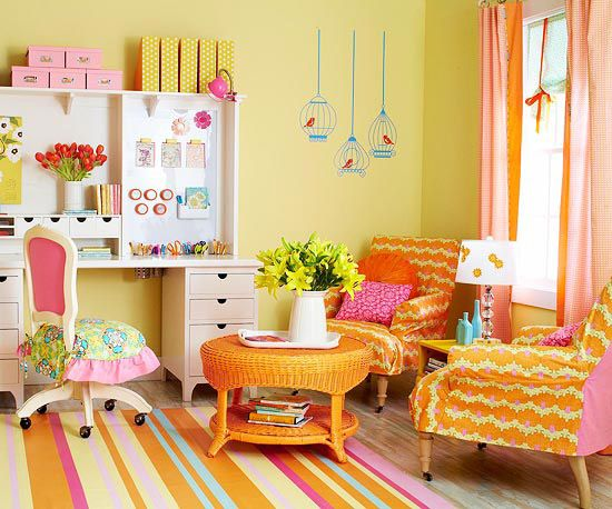 Cute and fun craft room.  I like the slipcovers - great way to add new colors and be kind to the budget.  Adore the desk chair remake.  And the wall unit. Been considering making a slipcover for a chair I have - this reminds me of the possibilities. Awesome for the aqua craft room and green carpet!!!