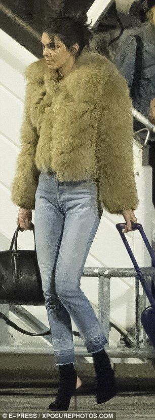 So fly: Jenner looked extremely fashionable as she touched down into Paris in her fur coat, while Bella did as well in her edgy black jacket and skin tight jeans