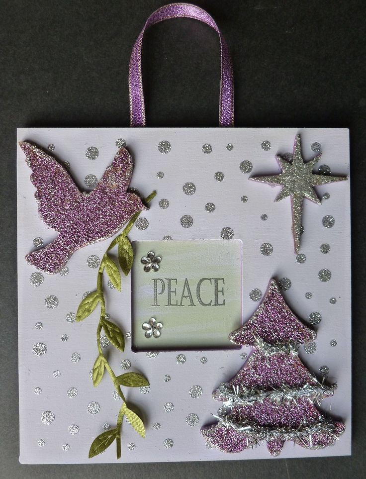 'Peace at Christmas'  MDF hanging wall plaque.   Imagination Craft's - Dove MDF Charm Kit.  Dove decoupage stamp set.  Snow dots stencil.  Chalkies - Agean & Cornflower.  Chalk white MDF paint.  Silver  & Silver Rose Sparkle Mediums.  Metal spatula.  Versamark pad.   Silver embossing powder.   Narrow silver tinsel.  October 2014
