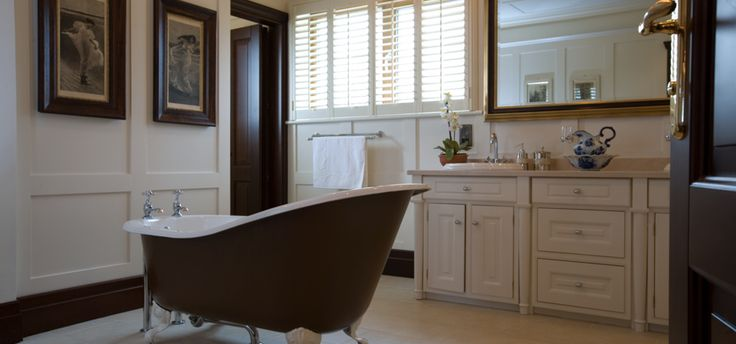 Paneled Walls & Antique Rolled Top Bath