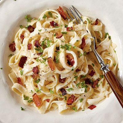 Recipe for Light Fettuccine Alfredo with Bacon - When you're short on time and the ingredient list is short, make every ingredient the freshest and best you can find. A real wood-smoked bacon imparts lots of flavor: Applewood is mild and slightly sweet, while hardwood, such as hickory, is more assertive.