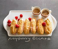 Raspberry Eclairs // Exquisite is the only word for these raspberry-filled delights. As elegant as this special Valentine's Day dessert looks, the pastries are surprisingly easy to prepare, bake, and fill.
