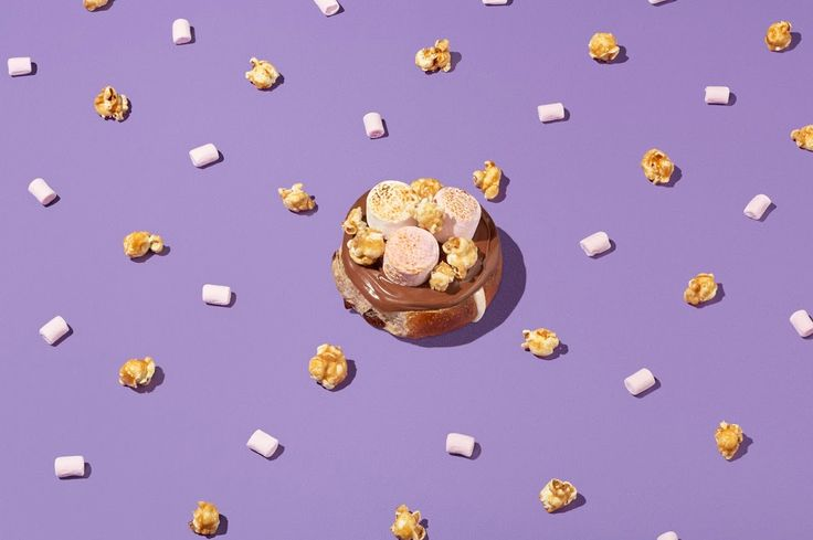 Nutella, toasted marshmallows and caramel popcorn on a hot cross bun. Say no more!