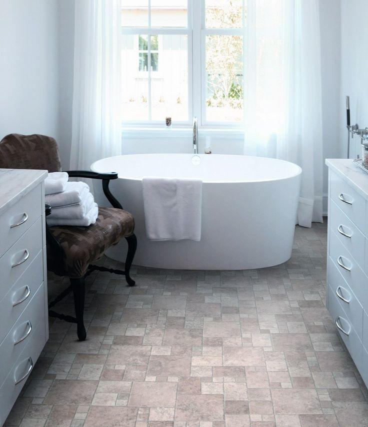 A stand-alone bath for a homey #bathroom with tile effect vinyl flooring #interior #design #bathroomideas