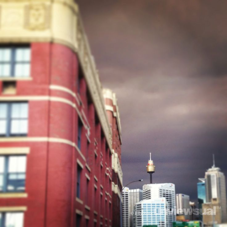 The city was covered in bushfire smoke that day. I'd never really noticed the wool store building before, but I like how it adds depth and draws the eye to the illuminated Sydney Tower and the clouds. 6.14pm, 17 October 2013, from Pyrmont ©Elly Rose