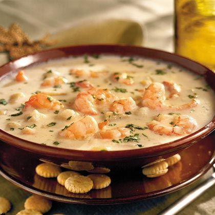 ---Quick Shrimp Chowder--- 2 tablespoons butter or margarine  1 medium onion, chopped  2 (10 3/4-ounce) cans cream of potato soup, undiluted  3 1/2 cups milk  1/4 teaspoon ground red pepper  1 1/2 pounds medium-size fresh shrimp, peeled*  1 cup (4 ounces) shredded Monterey Jack cheese  Garnish: chopped fresh parsley  Oyster crackers (optional)