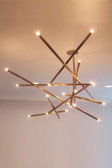 modern lighting fixture. crazy fun light that would be perfect in the right dining room so charming randomness of sticks and billy cotton pick up chandelier modern lighting fixture