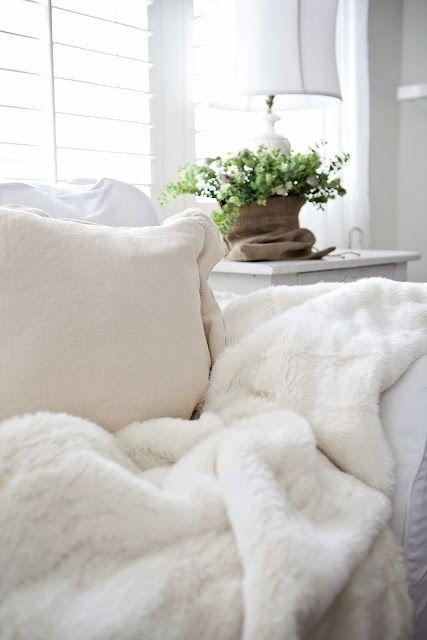 white on white on white; variety of texture; fur [faux] throw
