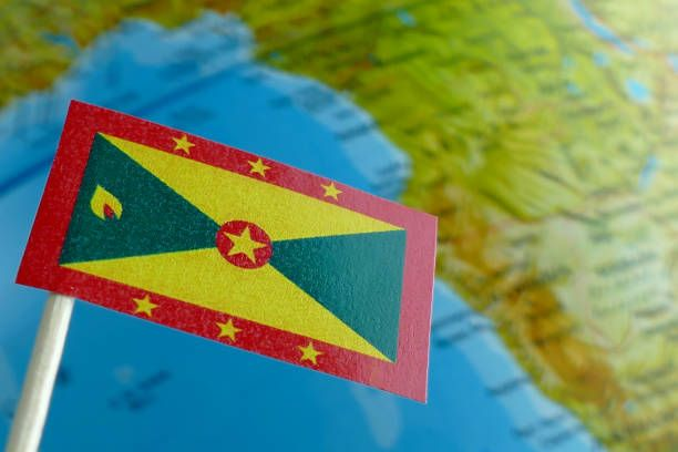 grenada flag with a globe map as a background macro