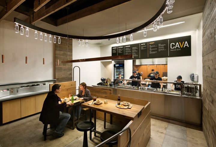 Cava Grill by Core Architecture Bethesda. This fast-food rollout prototype features a modern, Mediterranean style with simple, rustic finishes, custom copper light fixtures, and digital wall graphics depicting scenes of pastoral Greece.