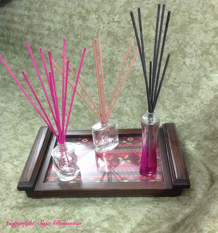 Empty perfume bottles, take the top off carefully, remove writings with acetone, pop in some aromatic sticks and voilà.
