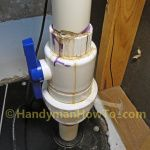How to Finish a Basement Bathroom: Set the sewage ejector pump in the sewage basin and connect the PVC plumbing to the main sewer line.