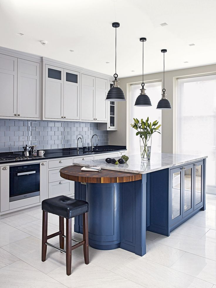 The latest colour trend for dark shades in the kitchen are great used to highlight an island unit in the kitchen, like the Farrow & Ball's Stiffkey Blue used in this Holloways of Ludlow kitchen.