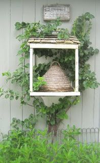bee skep in a box , with a little bit of roofing , and possibly a good sign...so good!