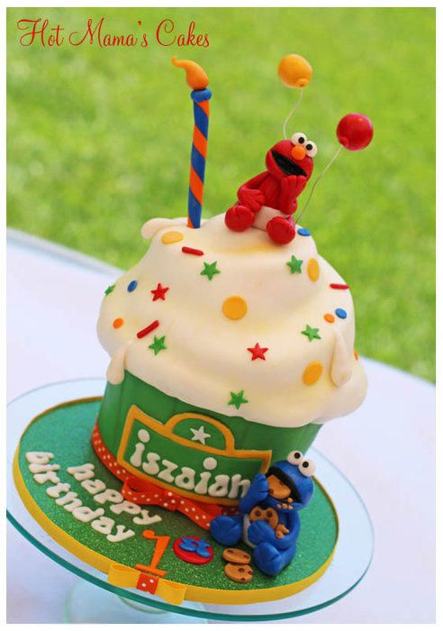 Figurines are made of fondant :) Cake inspiration is from Andrea's Sweet Cakes famous giant cupcake!